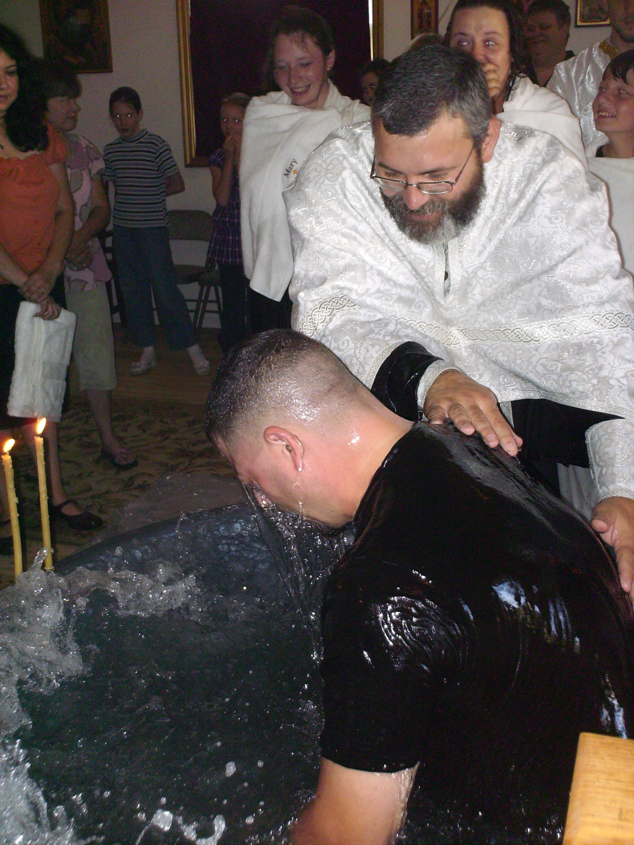 The Servant of God, Ephraim, is baptized in the name of the Father and of the Son and of the Holy Spirit.