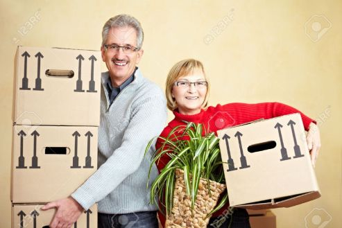 8903593-Two-happy-senior-people-with-many-moving-boxes-Stock-Photo-house