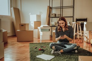 Young woman moving to a new apartment