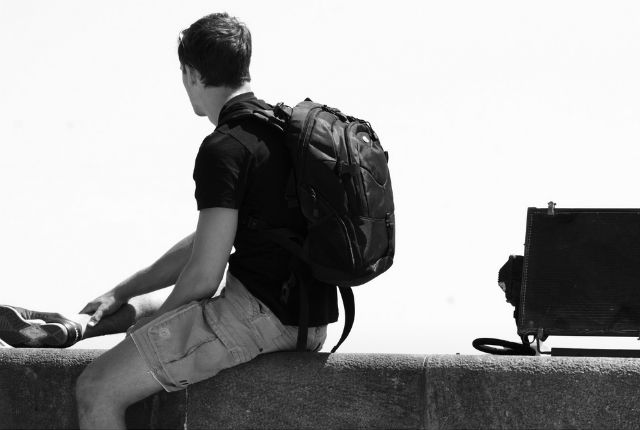 Guy traveling alone with backpack