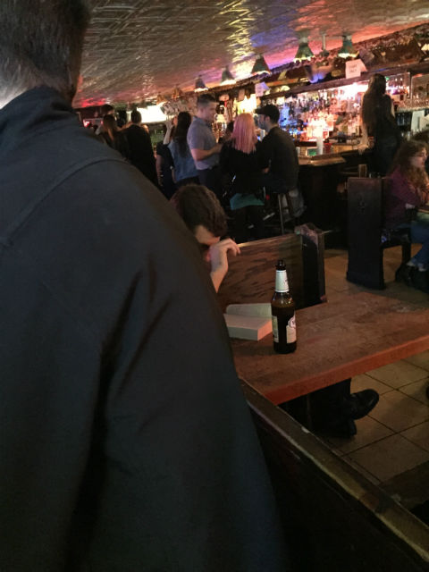 My Weekend in New York City - Guy reading a book at Peculiar Pub