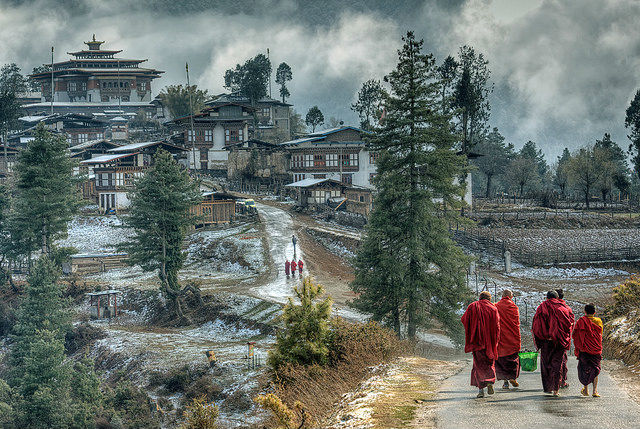 Challenges of Bhutan - Monks walking near a Monastery