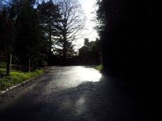 Nearly back again - and look at the sun shining off the wet roads.