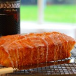 Loaf cake, knife and bottle of gin / Brockmans Gin and Orange Cake recipe / SHE-EATS
