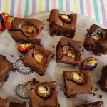 Several Creme egg brownies on a large serving plate / she-eats.com