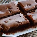 4 chocolate brownies on a rack