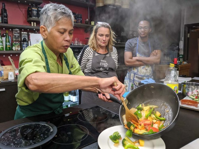 Chef plating up Thai food at cookery school