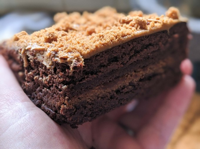 Close up of a biscoff brownie in a hand