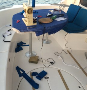 """the skipper said """"before we do anything else we have to finish the dinghi cover"""" and off he goes sewing..."""