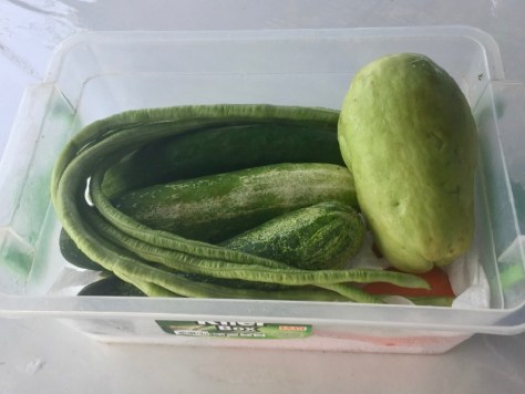Vegetables are stored in a box with kitchen towels