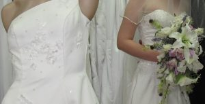 A close-up of the beautiful detail on two of the dresses