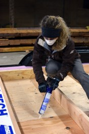 Caulking the plywood under carriage seam.