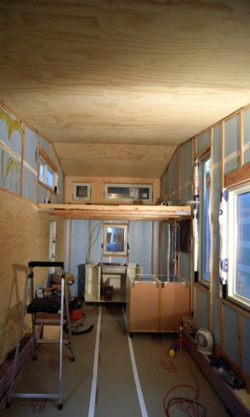 """The process of glueing and brad nailing the 1/4"""" paneling up"""