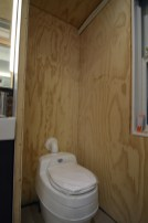 The access between the living space and the gear room has officially been severed and our composting toilet has been dry fit in place.