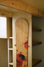 Under stair kitchen storage with the addition of functional art.