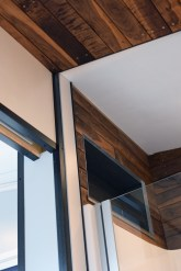 Bathroom detail of wood, glass and steel