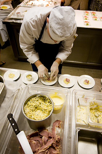 Busily plating food in the kitchen.