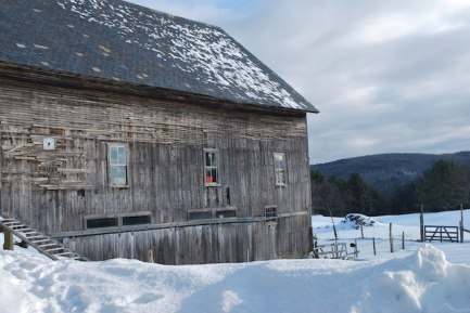 The slate-roofed barn in winter.