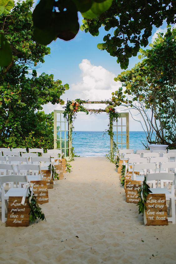 beach-wedding-ceremony-with-door-arch-and-wooden-aisle-marker-signs