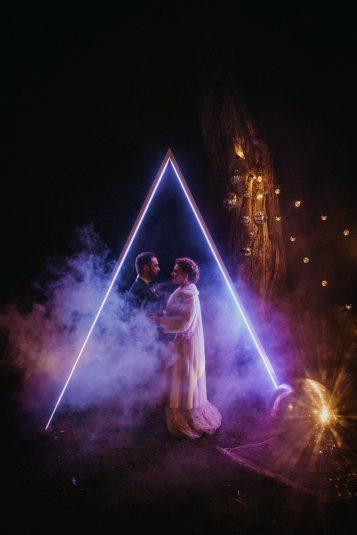 geometric LED illuminated triangle wedding arbours