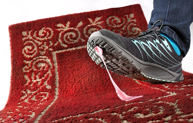 How to remove gum from an area rug.