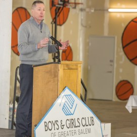 MA State Rep. Paul Tucker speaks at pop-up fundraiser for Boys and Girls Club of Greater Salem, MA 2016, in front of basketball mural.