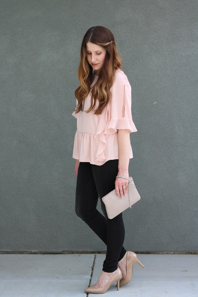 nude accessories, black jeans, pink ruffle top