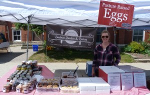 Photo by Marni Walsh Landman Gardens and Bakery served up fresh baked goods, preserves, eggs and meat to customers eager to purchase fresh locally grown food at Shelburne Farmer's Market new location at First and Owen Sound Streets. Landman's was one of many tented vendors delivering delicious produce at the market, including Besley's Farm, Kidd's Farm, Leitches' Honey, Hands On Catering, and many more. The market will run in its new location every Thursday from 3–7 p.m. throughout the growing season.