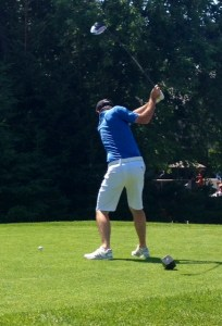Pro golfer Nic Taylor teeing off at the 1st hole