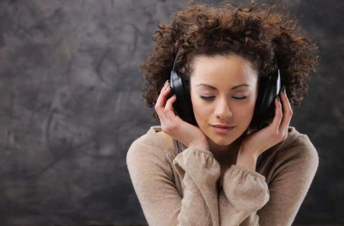Woman listening to hear God's voice