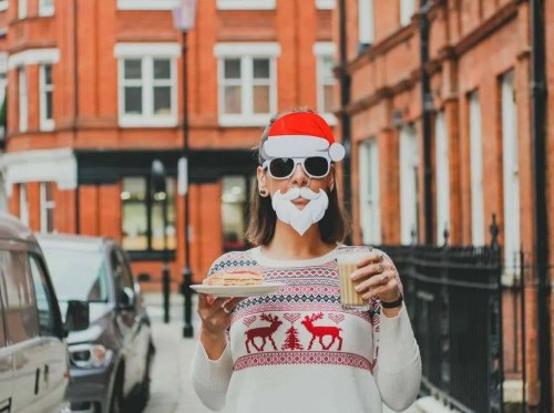 woman with silly Santa glasses