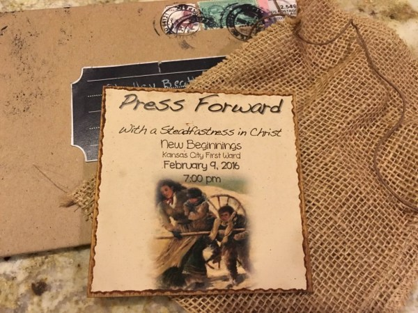 Invitation New Beginnings Press Forward done on a slab of wood, sent in burlap sack