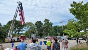 West Barnstable FD ladder truck with huge American Flag