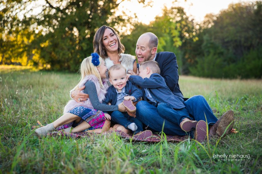 Family ticketing in grass {Lifestyle photographer, Prosper TX}