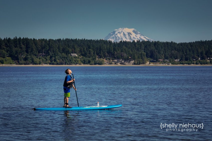 Shelly Niehaus Photography| Dallas Family Photography| Boy on Paddle Board in Front on Mt. Rainer
