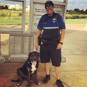 Officer McClendon with a dog she rescued from a bus stop