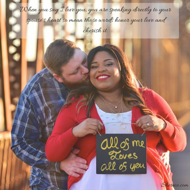 """Cute couple with man holding woman from behind she holds a sign that reads """"all of me loves all of you"""" and the quote reads """"When you say I Love You, you are speaking directly to your spouse's heart so mean those words honor your love and cherish it."""""""