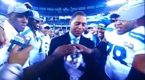Seahawk team laying their hands on the Vince Lombardi trophy