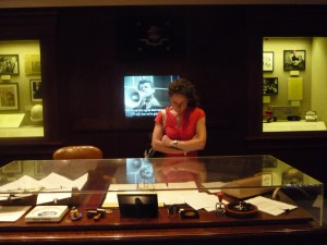 Olivia at the desk of Bobby Kennedy