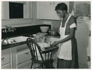 This could have been Miss Lucy and me in Mama's kitchen. (Click image for attribution.)
