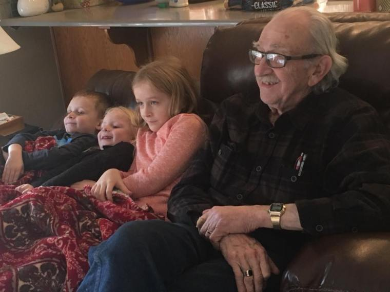 Grandpa Bob enjoying a movie with our greatgrands (L-R) Everett, Parker and Kylie.