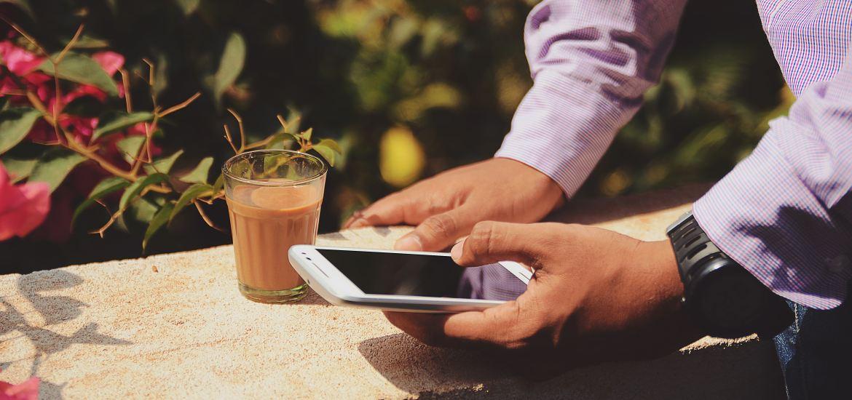 man using Smartphone, outside, coffee, hey mom!