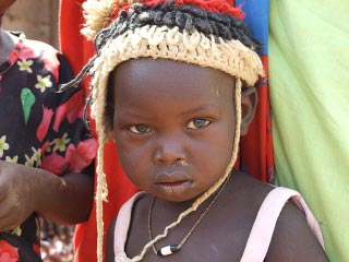 sudanese child in hat