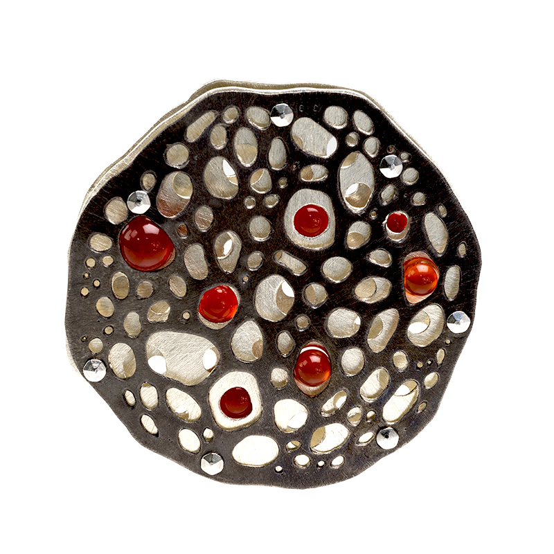 Three layer reversible sterling silver and stainless steel radiolaria inspired pendant with tension set carnelian spheres