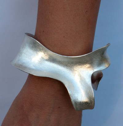 View of Whale Tale bracelet on a wrist