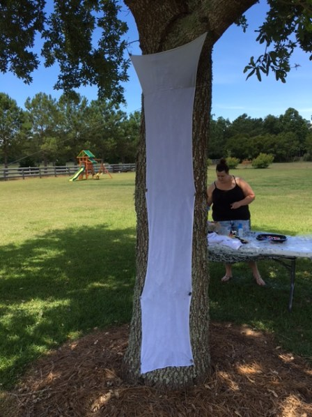 Yes, using a tree for vertical paint stand