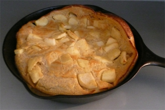 German pancake with apples in cast iron skillet