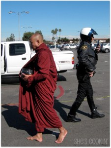 Monk passes a police officer in Little Saigon