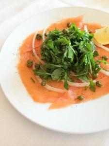 Salmon carpaccio with arugula