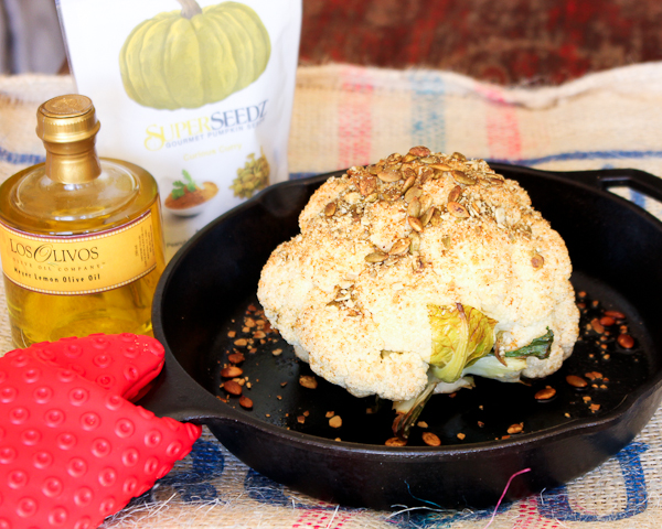 Roasted Cauliflower with Pumpkin Seeds and Curry Tahini Sauce | ShesCookin.com